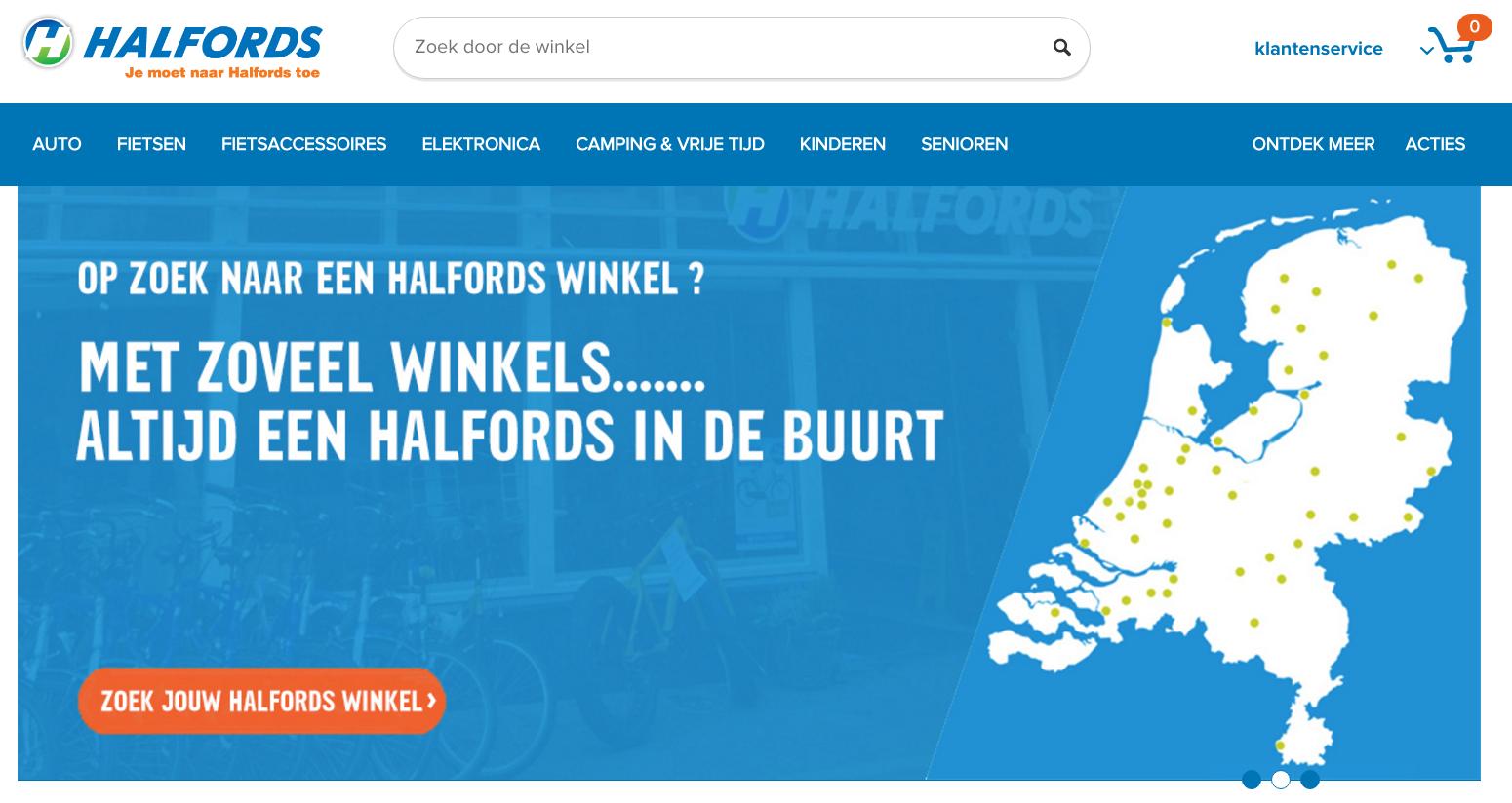 De header op de pagina van Halfords toont een kaart van Nederlad en verwijst naar de lokaties van winkels